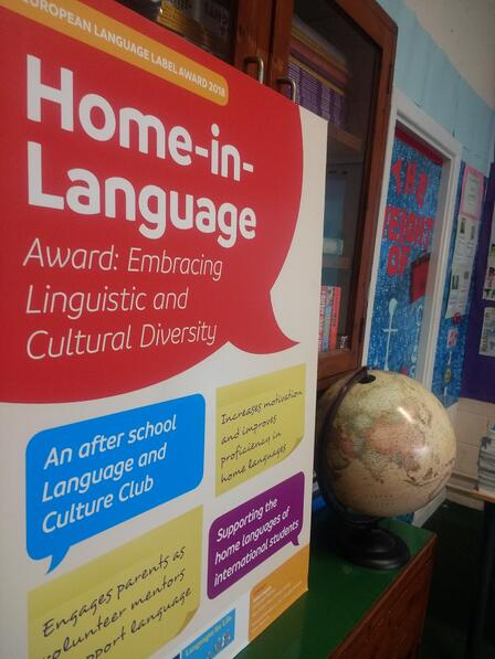 Home in Language poster in the school library